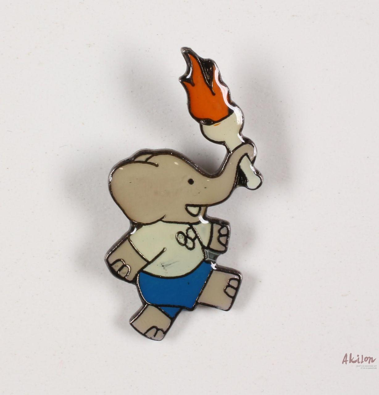 Pin's - Babar - Babar Porte La Flamme Olympique pour Singe De Babar